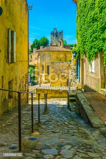 View of a narrow street leading to the tour du roy in Saint Emilion in France