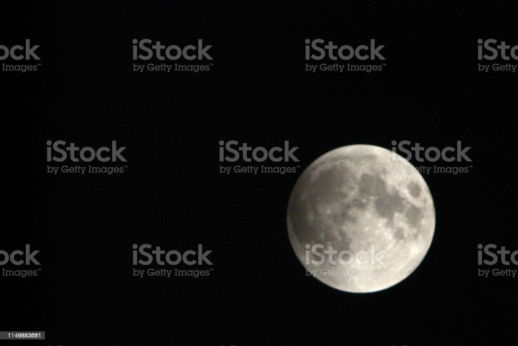 View, of a phase, of the lunar eclipse through a telephoto lens in...