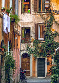 Rome, Italy, Feb 17 - A view of Vicolo Moroni, a typical alley of the Roman district of Trastevere, one of the oldest and most characteristic of the city of Rome. Built since the Imperial era, Trastevere owes its name to its position, beyond the Tiber River.