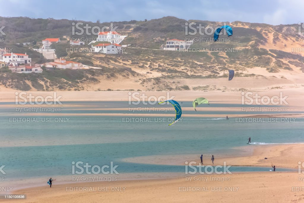 View of a professionals sports practicing extreme sports Kiteboarding...