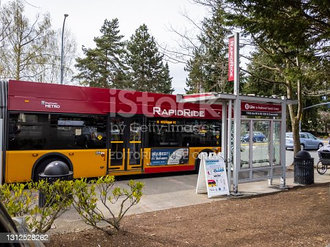 istock View of a Rapid Ride metro bus stopping at a bus stop on a sunny day 1312528262