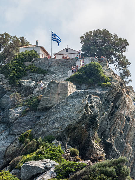 view of a remote greek chapel on skopelos island - mamma mia stock photos and pictures