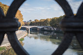 View of a Roman bridge over the Fiume Tevere in Rome Italy