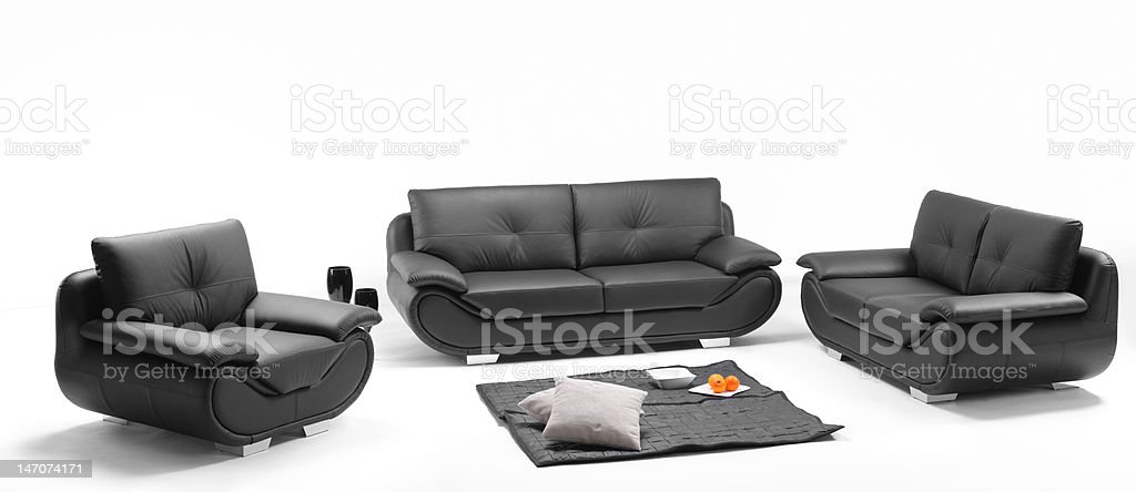 View of a room with black leather sofa royalty-free stock photo