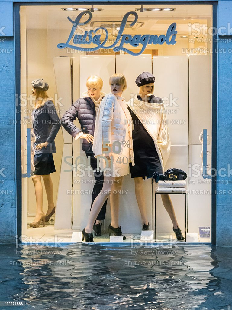 View of a shop front during the acqua alta floods stock photo