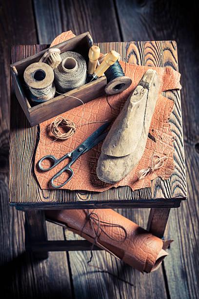 view of a small cobblers workshop handmaking shoes - remmar godis bildbanksfoton och bilder