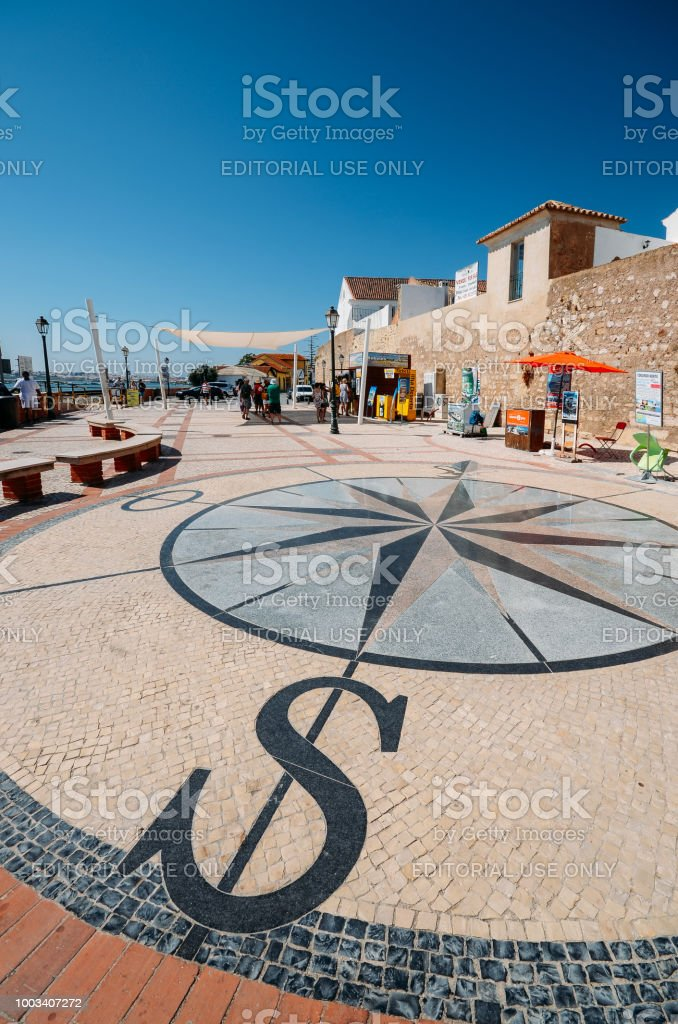 View of a stone pavement mosaic of a wind rose pattern. stock photo