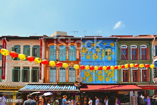 Singapore  A view of a street in Chinatown district with colorful old buildings and red and yellows lanterns decorations.