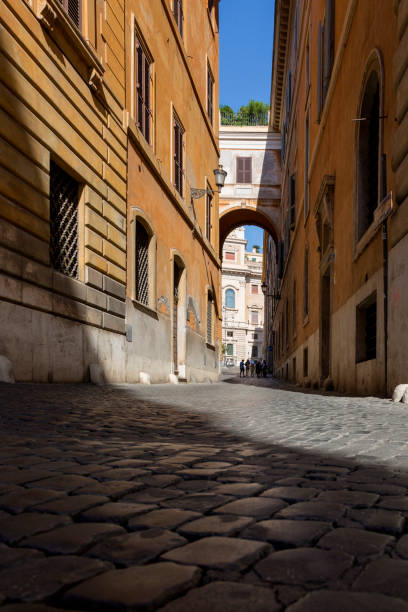 view of a street in the central part of rome - rome road central view foto e immagini stock