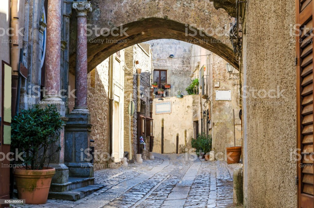 View of a street of erice with gothic arch stock photo