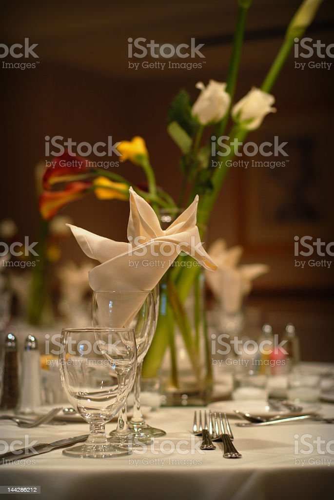 View of a table setting and floral centerpiece at a wedding royalty-free stock photo