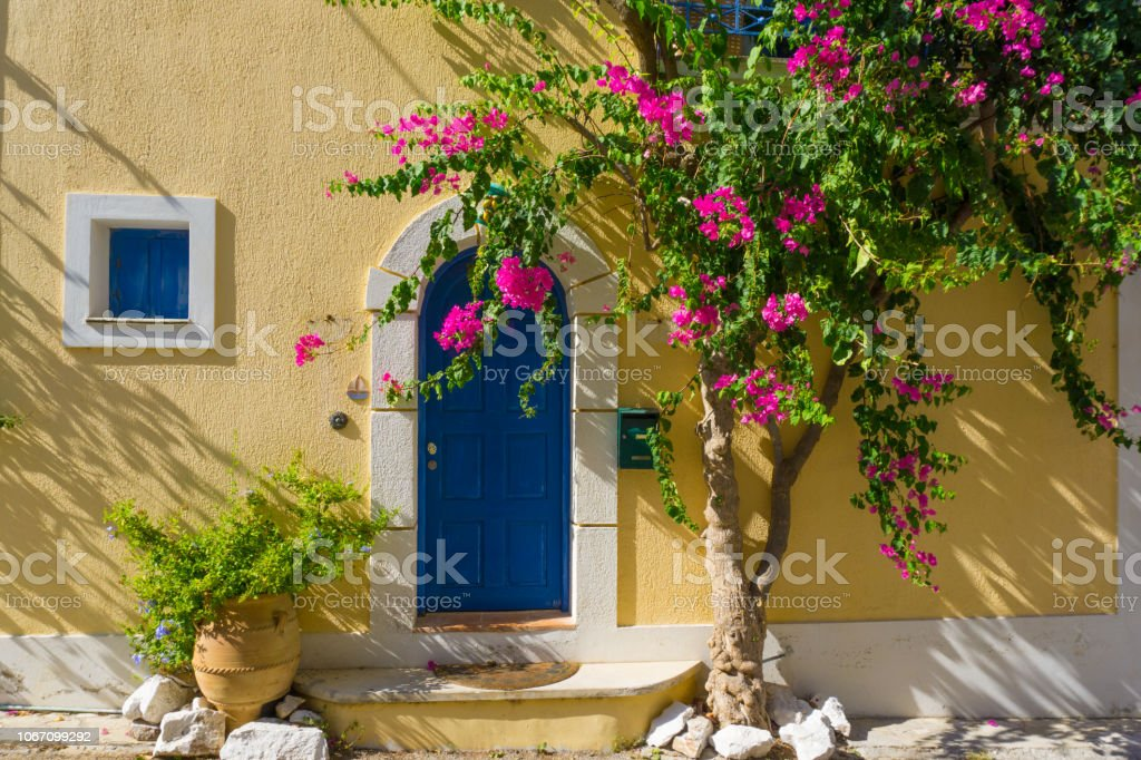 View of a traditional house with voukamvillia flower in Assos village, Kefalonia, Greece stock photo