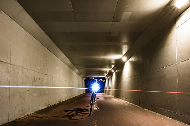 View of a tunnel with a parked bicycle stock photo