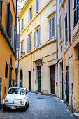 Rome, Italy, June 01 -- A view of a alley in the center of Rome, near Via del Governo Vecchio and Piazza Navona aerea, with an Italian vintage car parking. Image in HD format