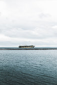 Dramatic view of shipwreck in the ocean during cold summer day in Chilean Patagonia