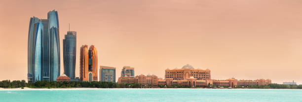 view of abu dhabi skyline on a sunny day, uae - abu dhabi стоковые фото и изображения