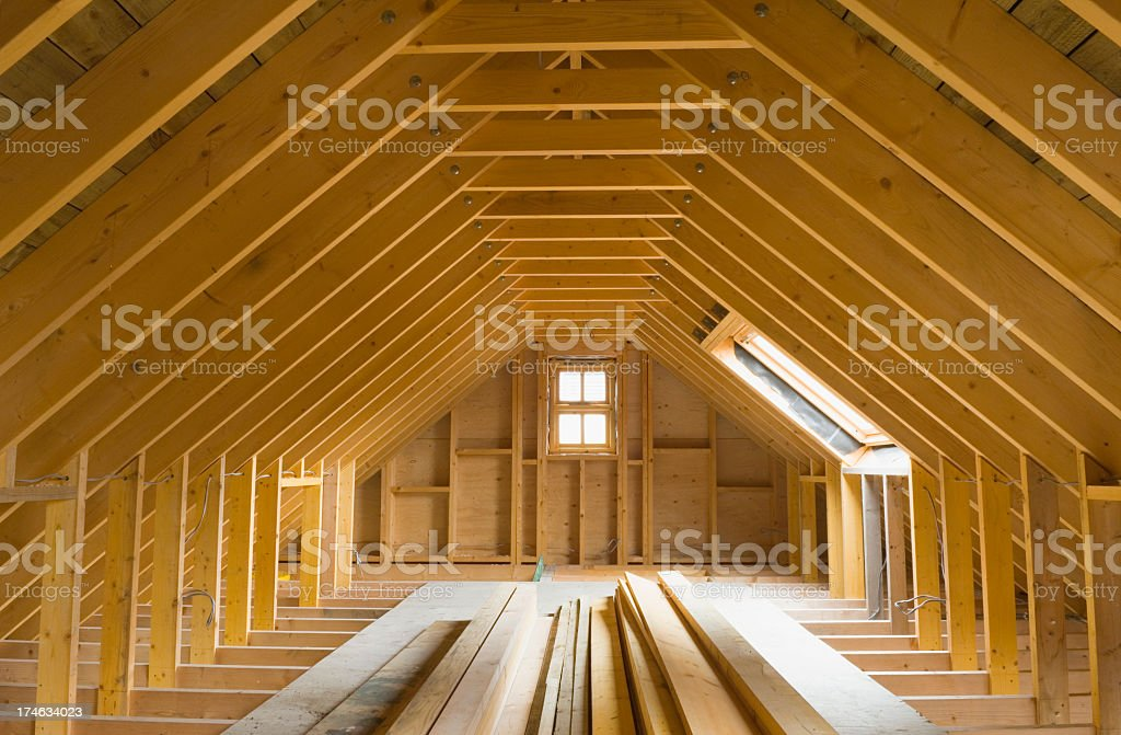 View of A-frame attic in a newly-built home Attic space in newly-built house, ready for conversion. Wiring has been done. Architectural Feature Stock Photo