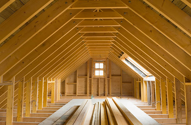 View of A-frame attic in a newly-built home Attic space in newly-built house, ready for conversion. Wiring has been done. attic stock pictures, royalty-free photos & images