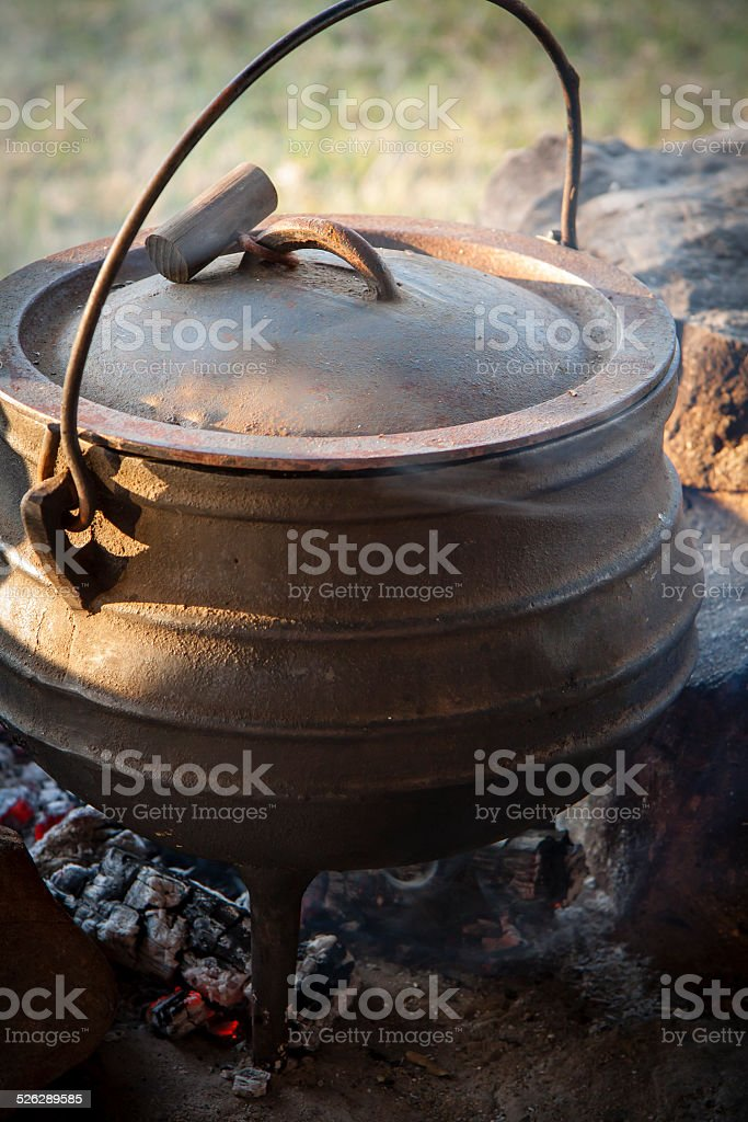 View of afrikaner potjie pot kissing on fire coals stock photo