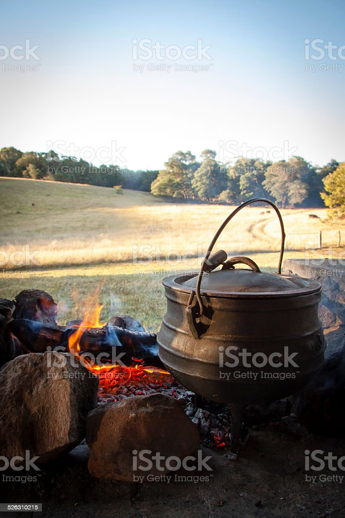 View of afrikaner potjie pot sitting on fire coals stock photo