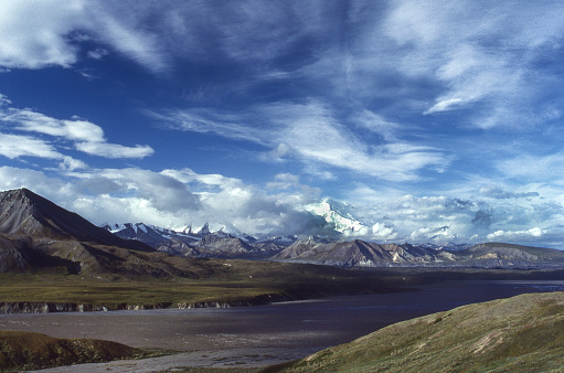 View of  tundra, distant mountains and clouds in Denali National Park.  Taken in Denali National Park, Alaska, USA