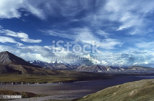 View of  tundra, distant mountains and clouds in Denali National Park.\n\nTaken in Denali National Park, Alaska, USA