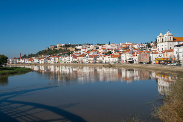 view of alcacer do sal cityscape from the other side of the sado river - setubal imagens e fotografias de stock