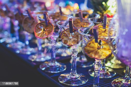 istock View of alcohol setting on catering banquet table, row line of different colored alcohol cocktails on a party, martini, vodka, and others on decorated catering bouquet table event 1186961785
