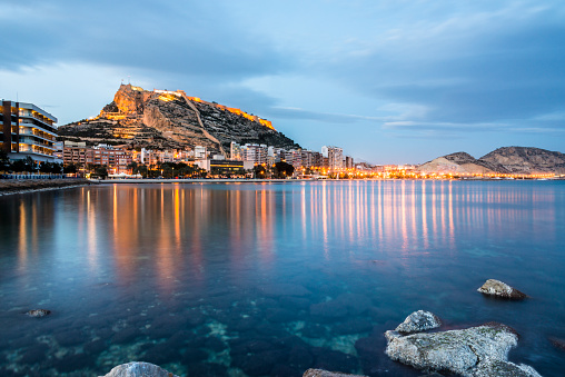 View of Alicante at dusk from the sea, Costa Blanca, Valencia province. Spain.