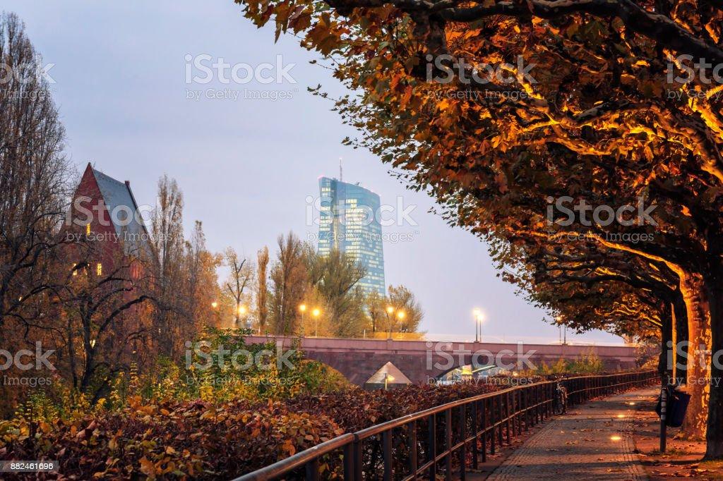 View of Alte Brucke and European Central Bank from Schaumankai promenade in Frankfurt am Main at dusk stock photo