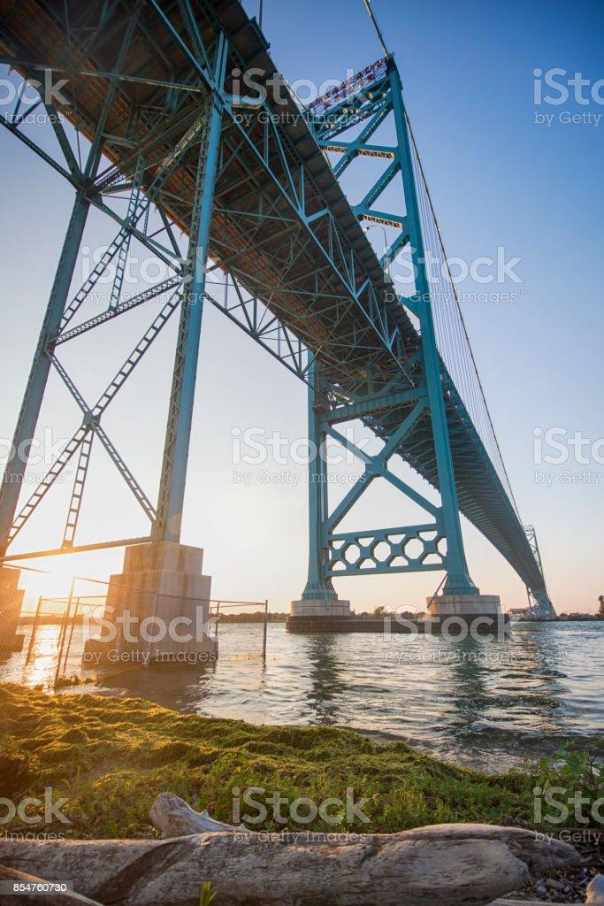 View of Ambassador Bridge connecting Windsor, Ontario to Detroit Michigan at sunset time stock photo