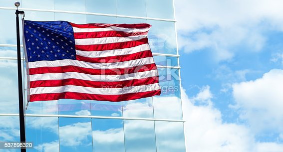 537898300istockphoto View of American flag on blue building background 537898320