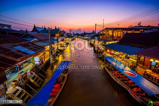 Samut Songkhram, Thailand - 24 February 2019: View of Amphawa Floating Market Towns and tourists walk shopping, eat and take pictures around the area. There are many restaurants in the area. Is one of the most popular floating markets in Thailand