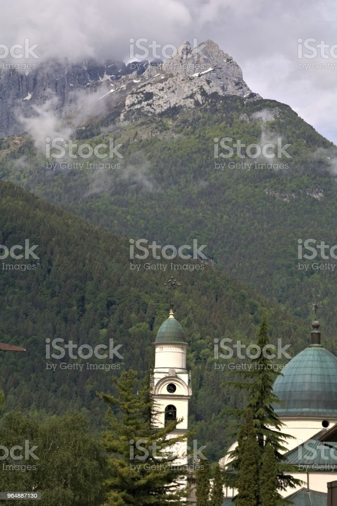 view of an alpine mountain landscape with church tower in the dolomites royalty-free stock photo