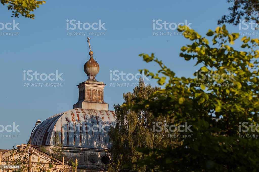 View of an old temple with lop-sided cross stock photo