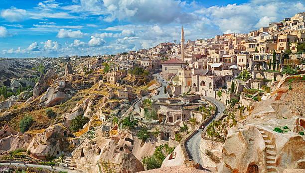 view of ancient nevsehir cave town and  castle of uchisar - hotels in der türkei stock-fotos und bilder