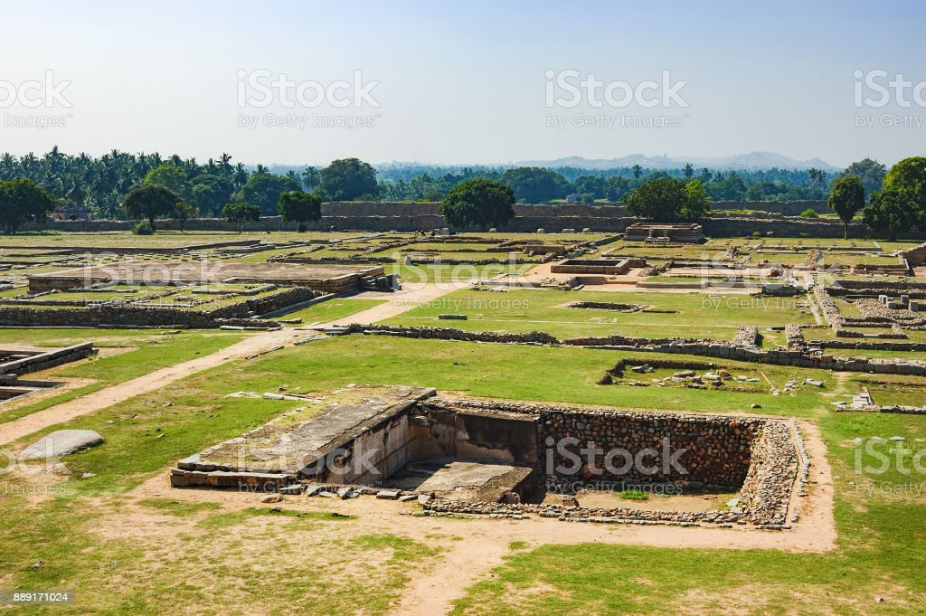 View of ancient stepwell in Hampi, India. stock photo