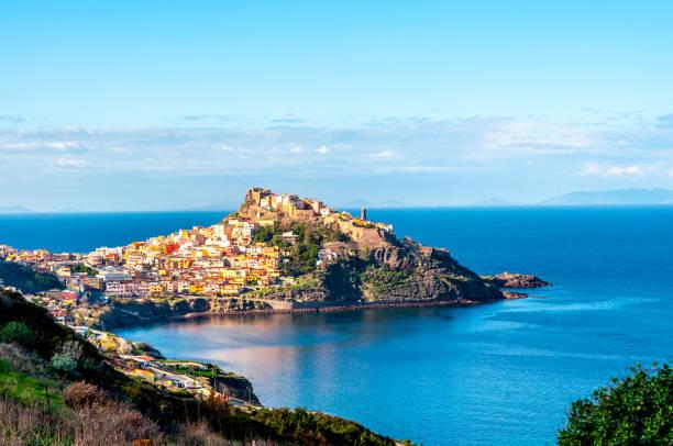 view of ancient village on the coast - sardegna foto e immagini stock