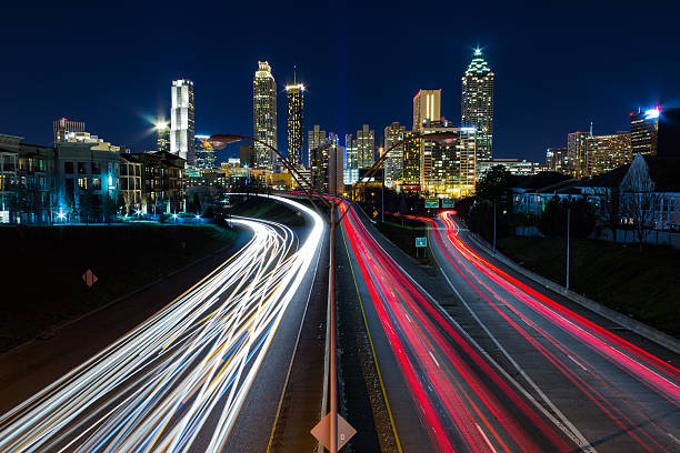 view of atlanta from jackson street bridge - long exposure stock pictures, royalty-free photos & images