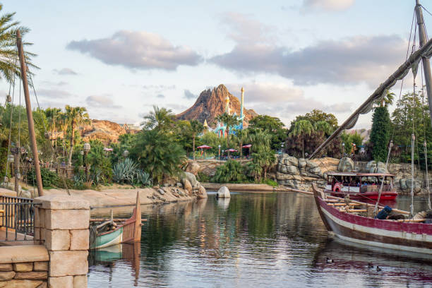 View of Attractions activity cruising in mediterranean harbor with volcano stock photo