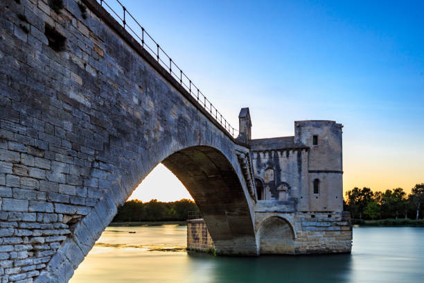 View of Avignon bridge, the medieval Saint Benezet Bridge at sunset, Avignon, southern France. stock photo