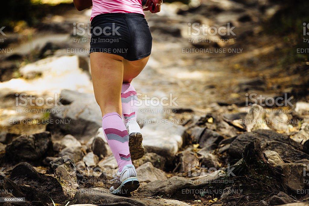 view of back woman marathon runner stock photo