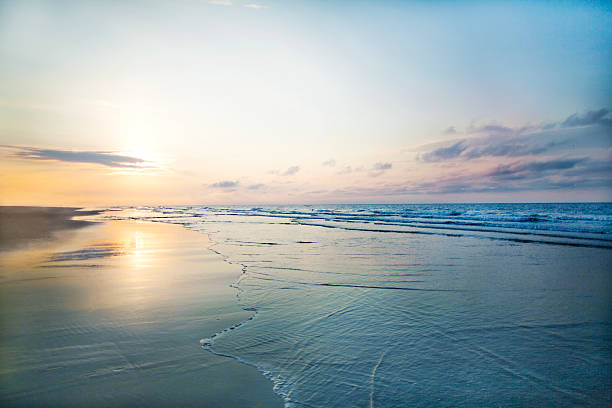 View of beach sunrise View of beach sunrise tranquil scene stock pictures, royalty-free photos & images