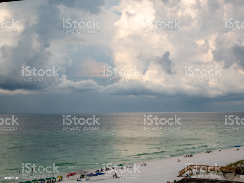 View of Beach With Calm Ocean with Storm Coming stock photo