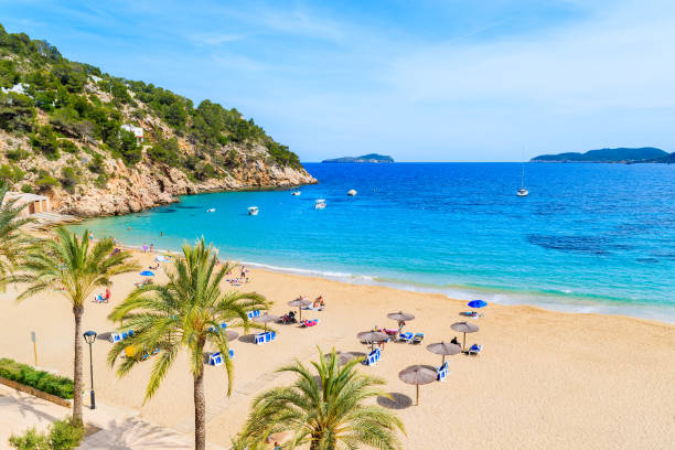 View of beautiful beach and sea bay in Cala San Vicente, Ibiza island, Spain Ibiza is an island in the Mediterranean Sea off the east coast of Spain. It is the third largest of the Balearic Islands. sailing dinghy stock pictures, royalty-free photos & images