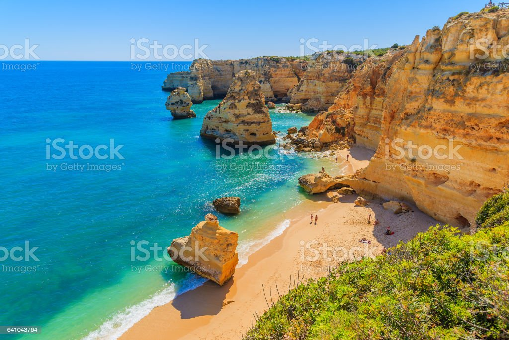 View of beautiful Marinha beach with crystal clear turquoise water near Carvoeiro town, Algarve region, Portugal stock photo