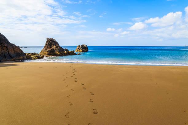 view of beautiful prainha beach with footprints on golden sand, madeira island, portugal - funchal madeira imagens e fotografias de stock