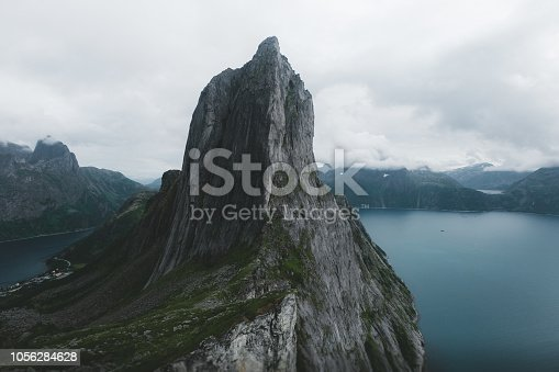 View of huge cliffs, mountain and northern sea on Senja island