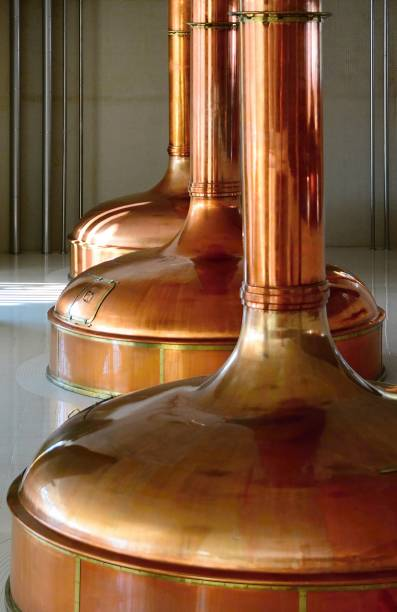 view of beer brewery interior with traditional fermenting copper vats. - brewery tanks stock pictures, royalty-free photos & images