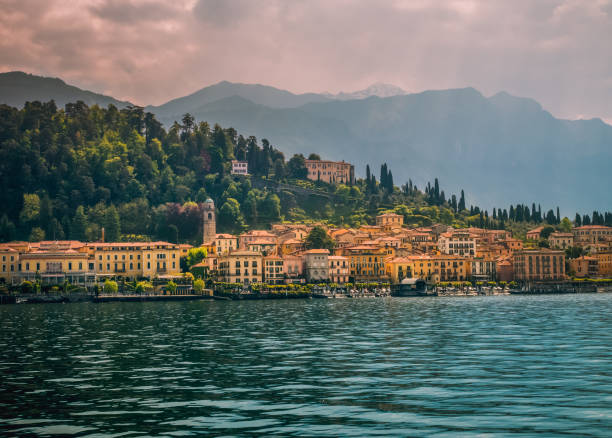 view of bellagio town. lake and mountains. como lake, italy. - lake como stock photos and pictures